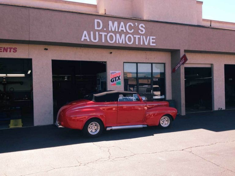 red classic car in front of D. Mac's Automotive